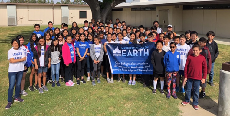 Students with Happiest Class on Earth banner